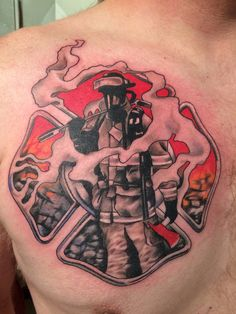 Attractive Firefighter Tattoo On Man Chest