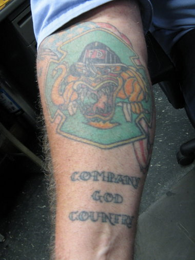 650494f96 Colored Firefighter Tattoo On Right Forearm