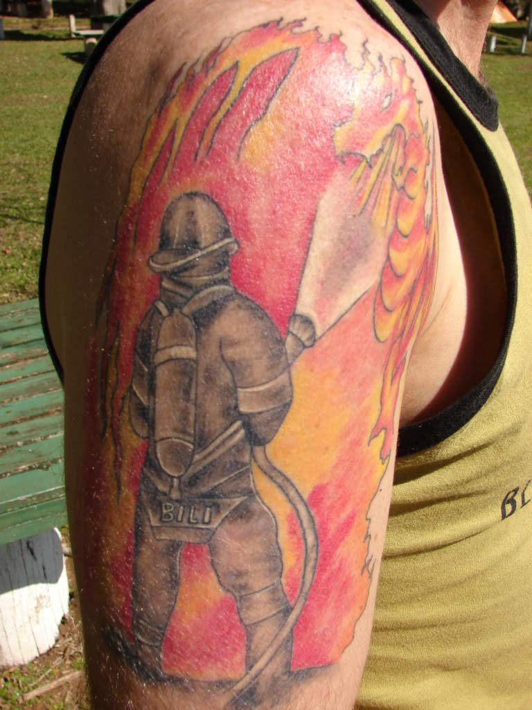 Firehighter Working Tattoo On Half Sleeve