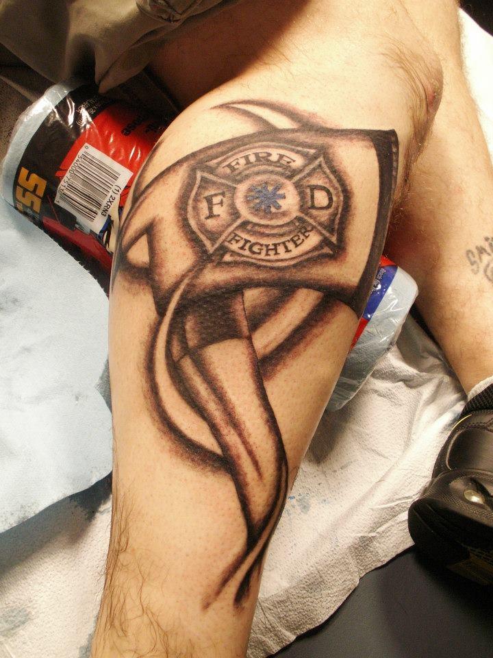 Grey Ink Firefighter Tattoo