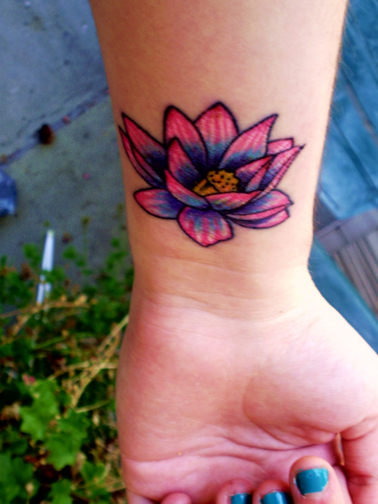 Awesome colored lotus flower tattoo on upperback awesome colored flower tattoo on left wrist izmirmasajfo