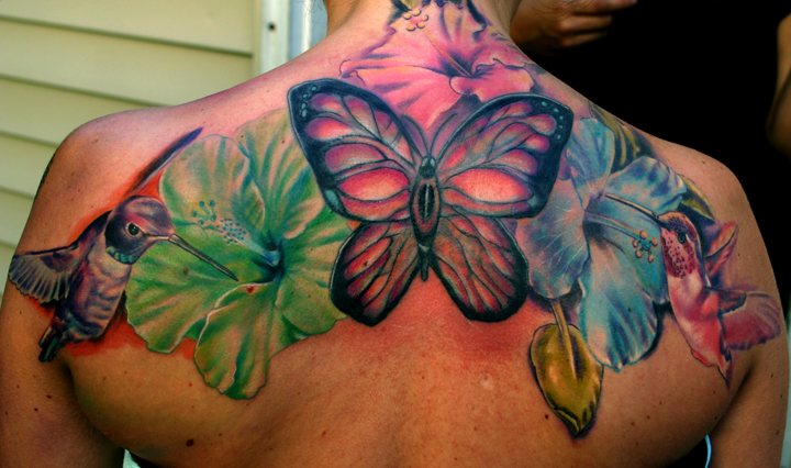Colored Butterflies And Hibiscus Flower Tattoos On Upperback
