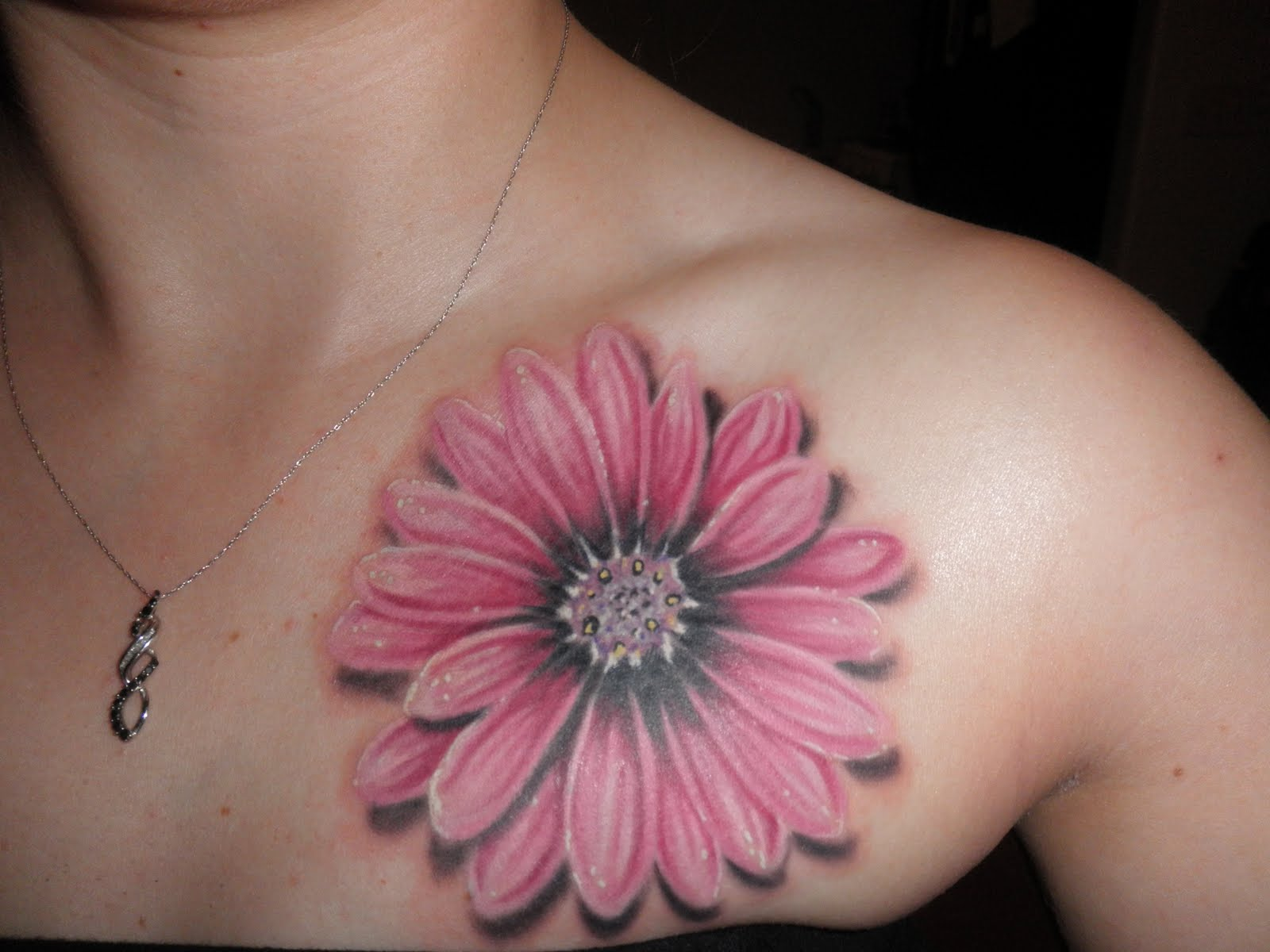 Daisy flower tattoo on collarbone izmirmasajfo