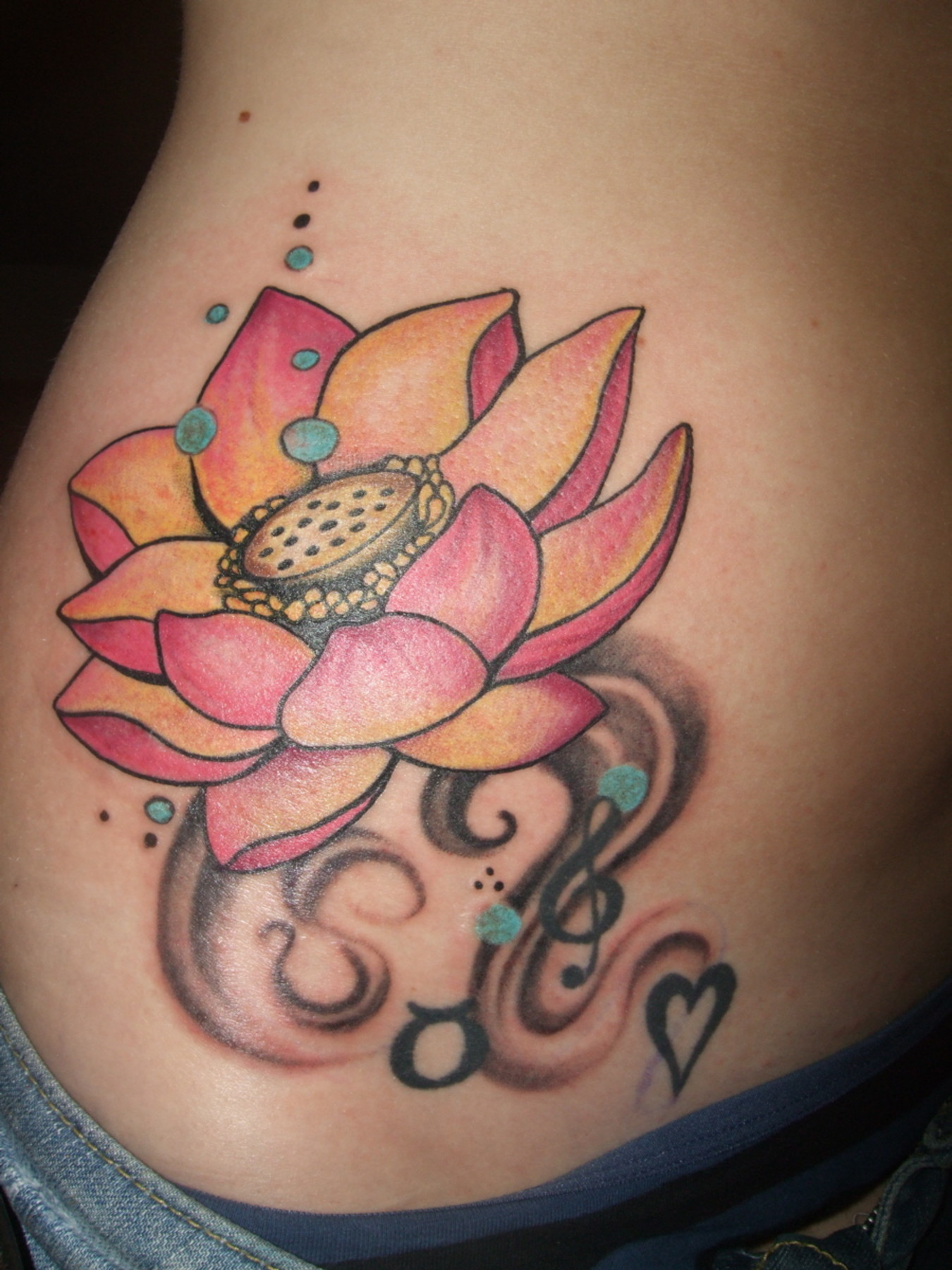 Lotus flower tattoo on side izmirmasajfo