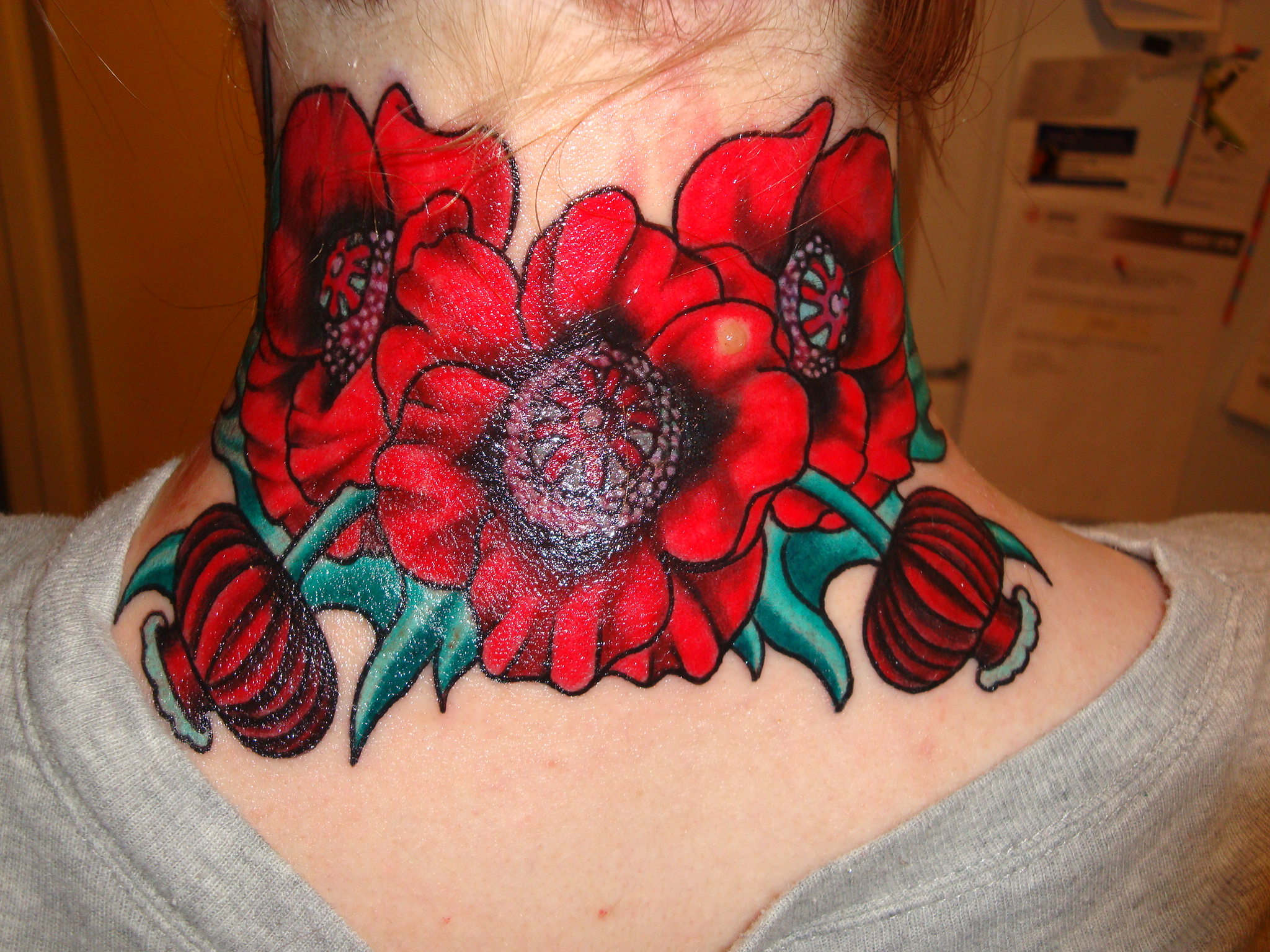 Red flowers tattoos on neck izmirmasajfo