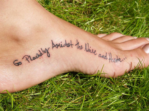 Black Ink Lettering Tattoo On Left Foot