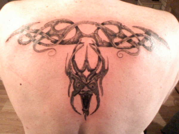 Tribal And Gargoyle Tattoo On Upperback