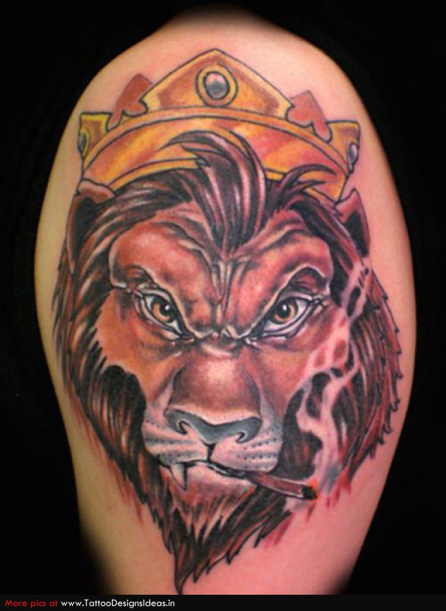 Colored Lion Head With Crown Tattoo On Shoulder
