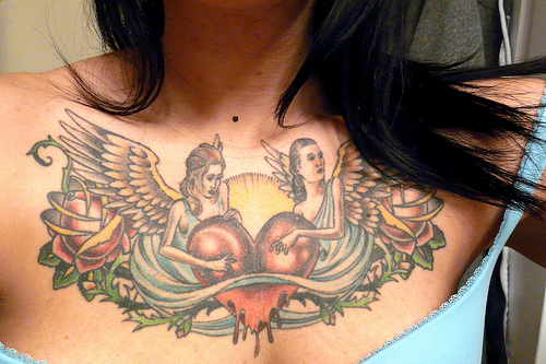 Angel womens with heart chest tattoo for Chest tattoos for women