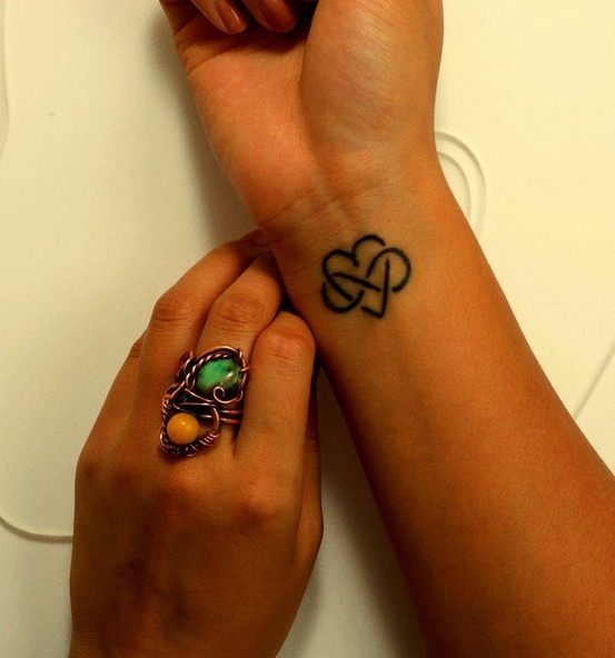 Small Heart And Infinity Symbol Tattoo
