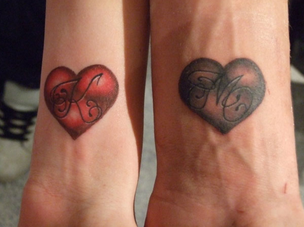 Grey and red heart tattoos on wrists for Pink heart tattoo