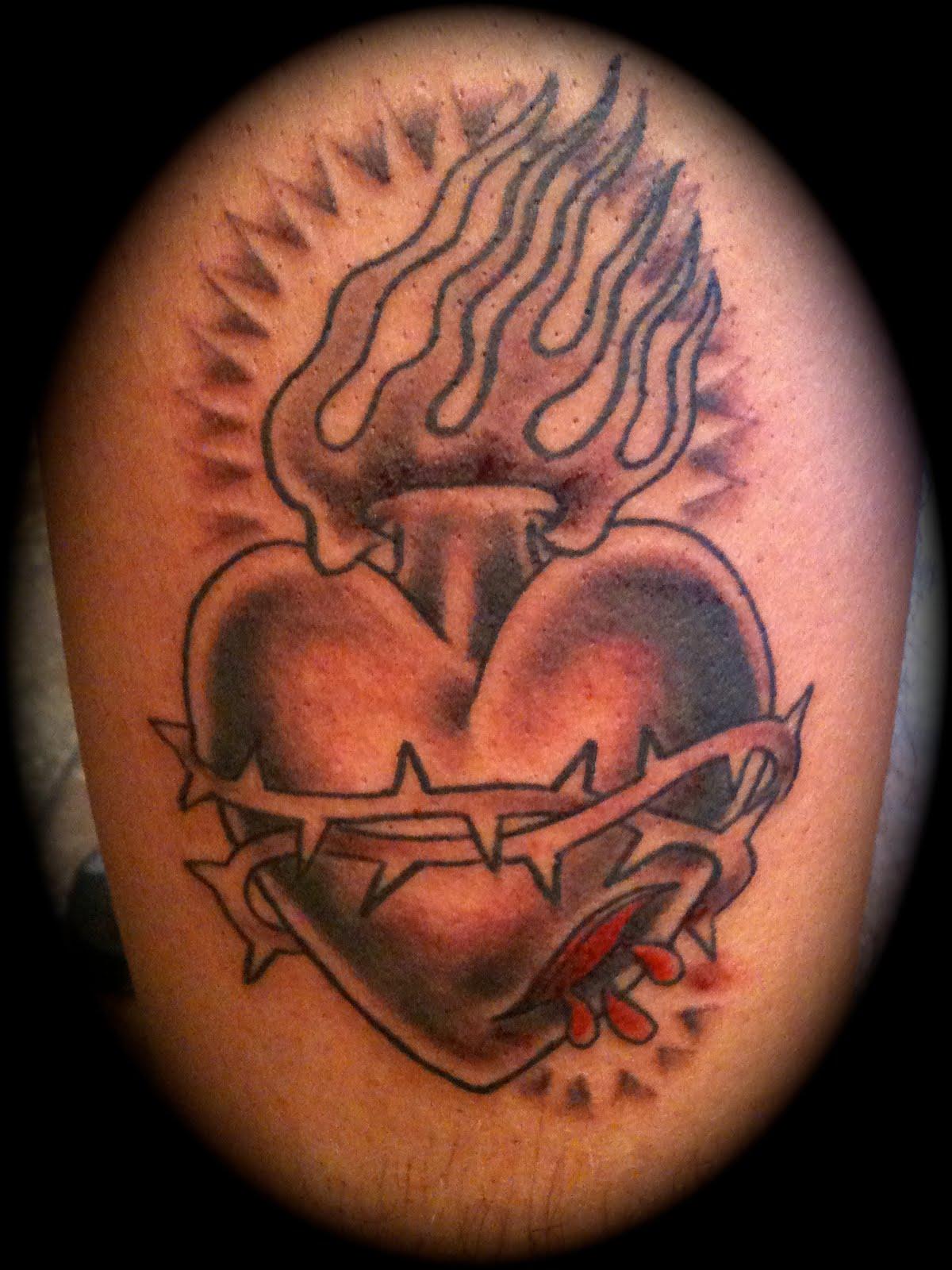 Grey Ink Sacred Heart Tattoo