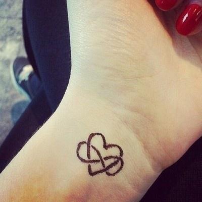 Infinity Symbols And Heart Tattoo On Left Wrist