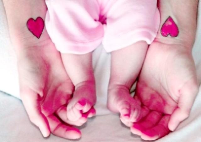 Pink Heart Tattoo On Wrist