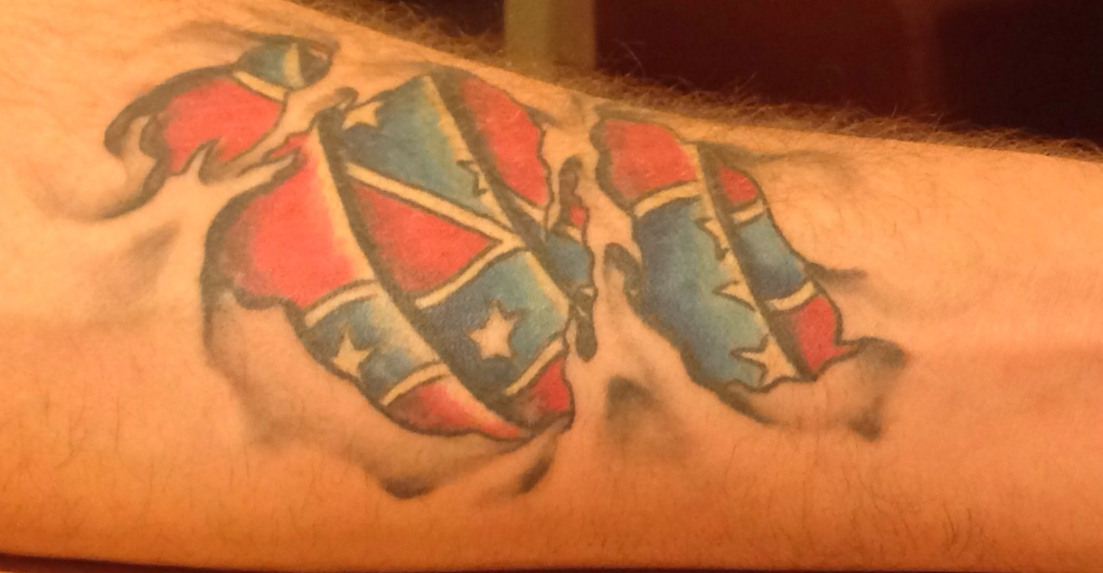 Ripped Skin Flag Tattoo On Arm