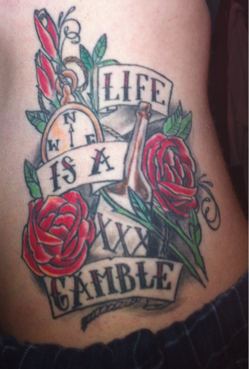 Red Rose Flowers And Gamble Tattoo On Side Rib