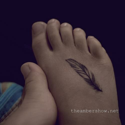 Lion and tiger 25 divine girl quote tattoo ideas for Feather foot tattoo