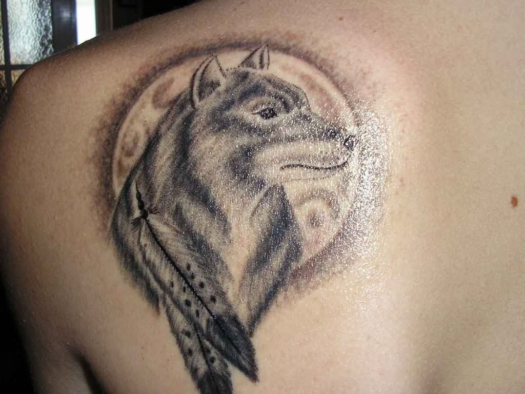 Wolf and feather tattoo for Tattoos of wolves