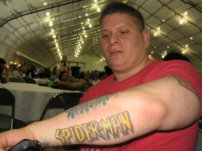 Spiderman Geek Tattoo On Left Arm