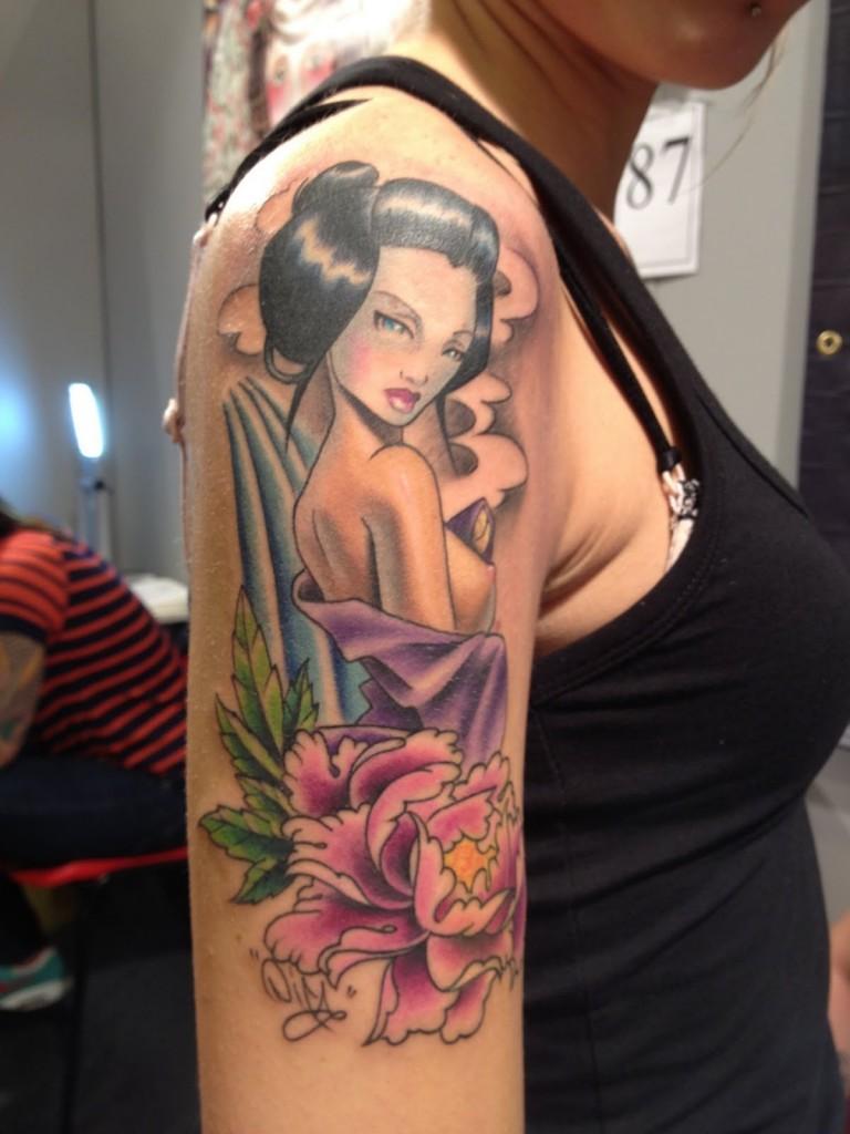 Flower and geisha tattoo on right half sleeve
