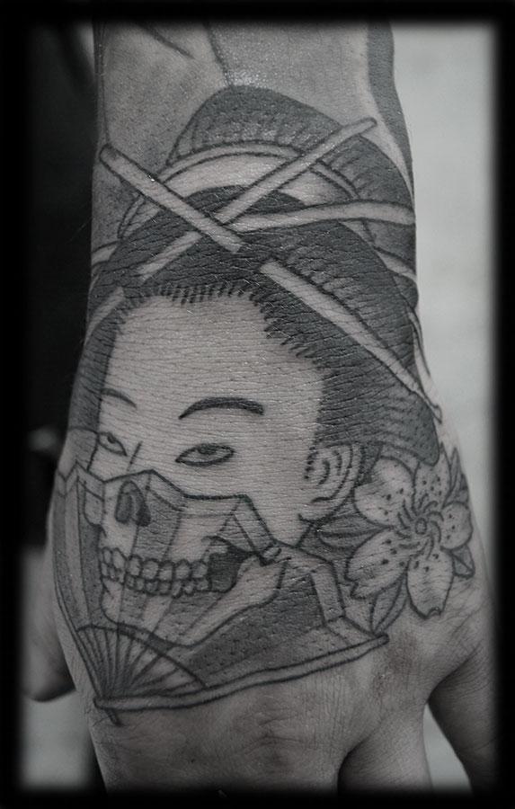 Grey Flower And Geisha Girl Head Tattoo On Left Hand