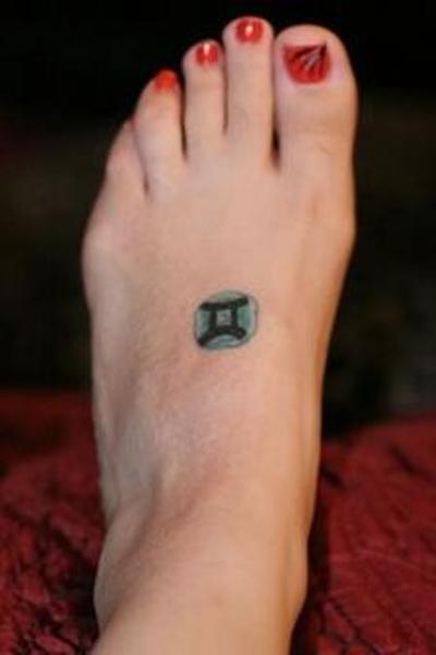 Small Zodiac Sign Of Gemini Tattoo On Left Foot
