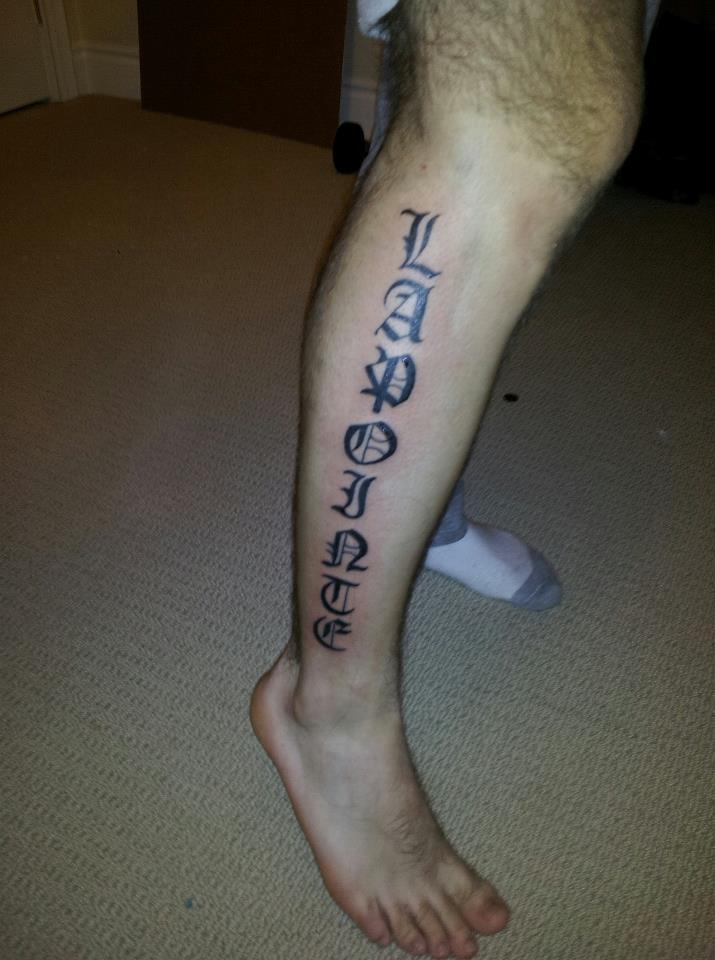 Gothic Font Tattoo On Side Leg