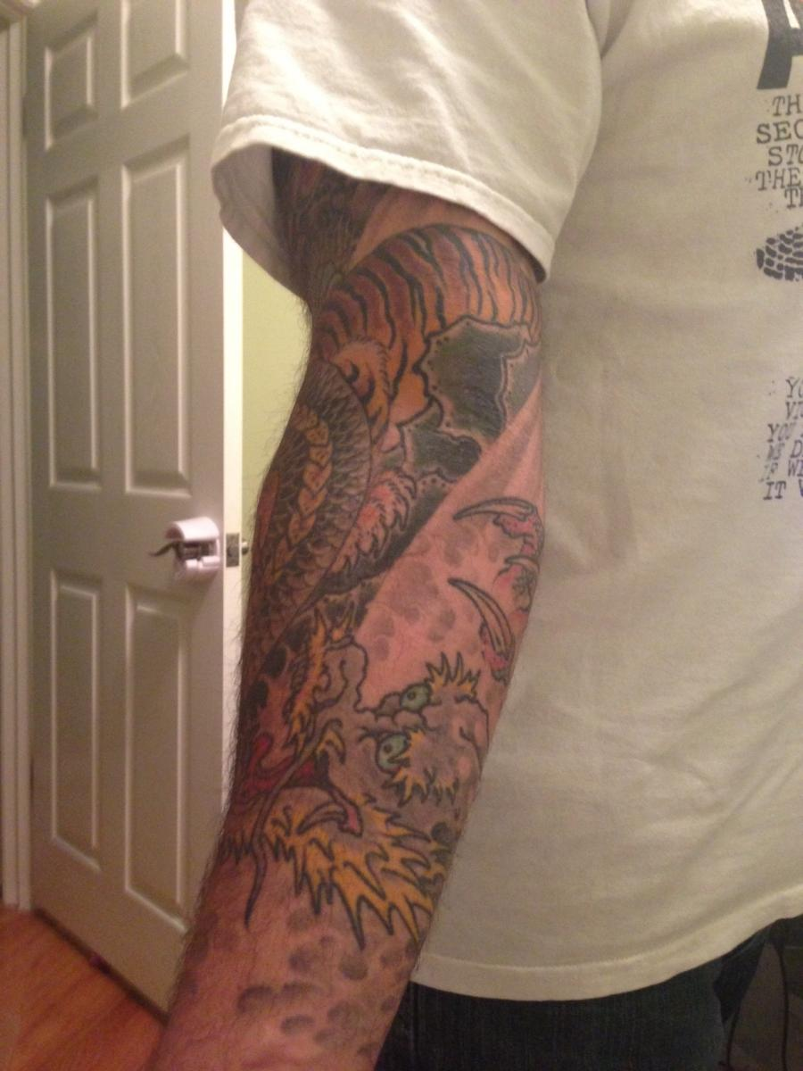 Cute Grey Ink Tiger Tattoo On Man Left Sleeve