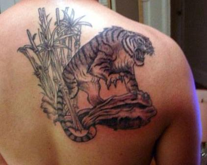 Grey Ink Bamboo Trees And Wolf Tattoo On Leg