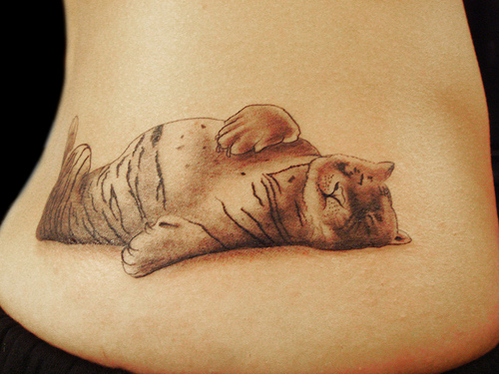 Grey ink cute sleeping tiger tattoo on lowerback for Panther tiger tattoo