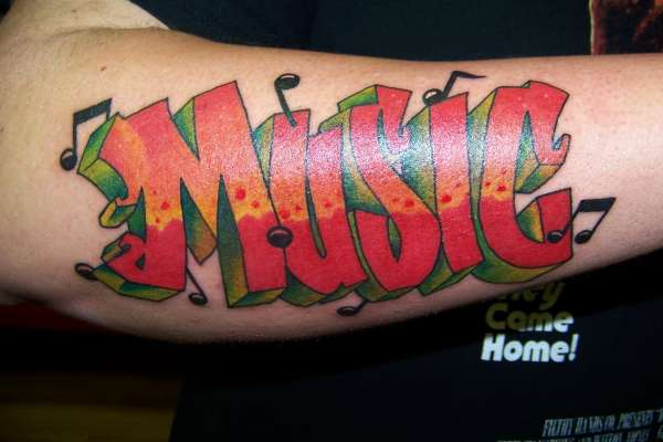Music graffiti tattoo on man right sleeve for Graffiti tattoos sleeves