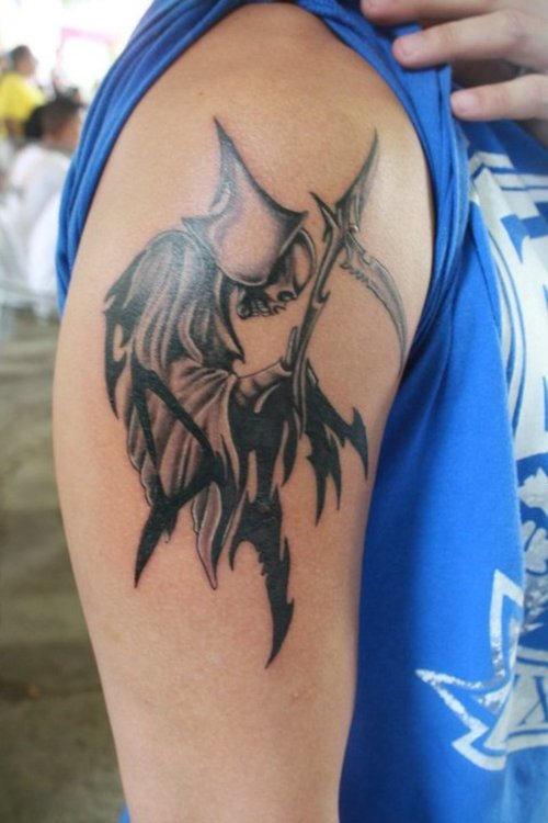 Black And Grey Ink Tribal Grim Reaper Tattoo On Biceps