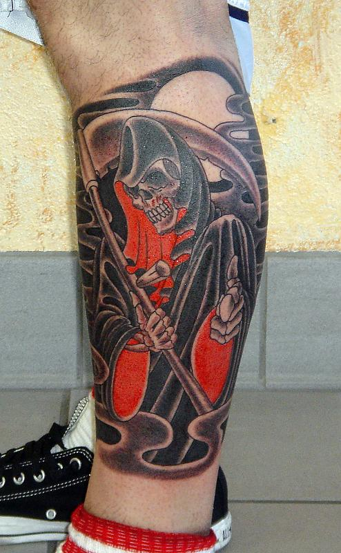 Black Ink Grim Reaper Tattoo On Left Leg
