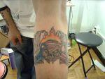 Skull and Flag Tattoo On Arm