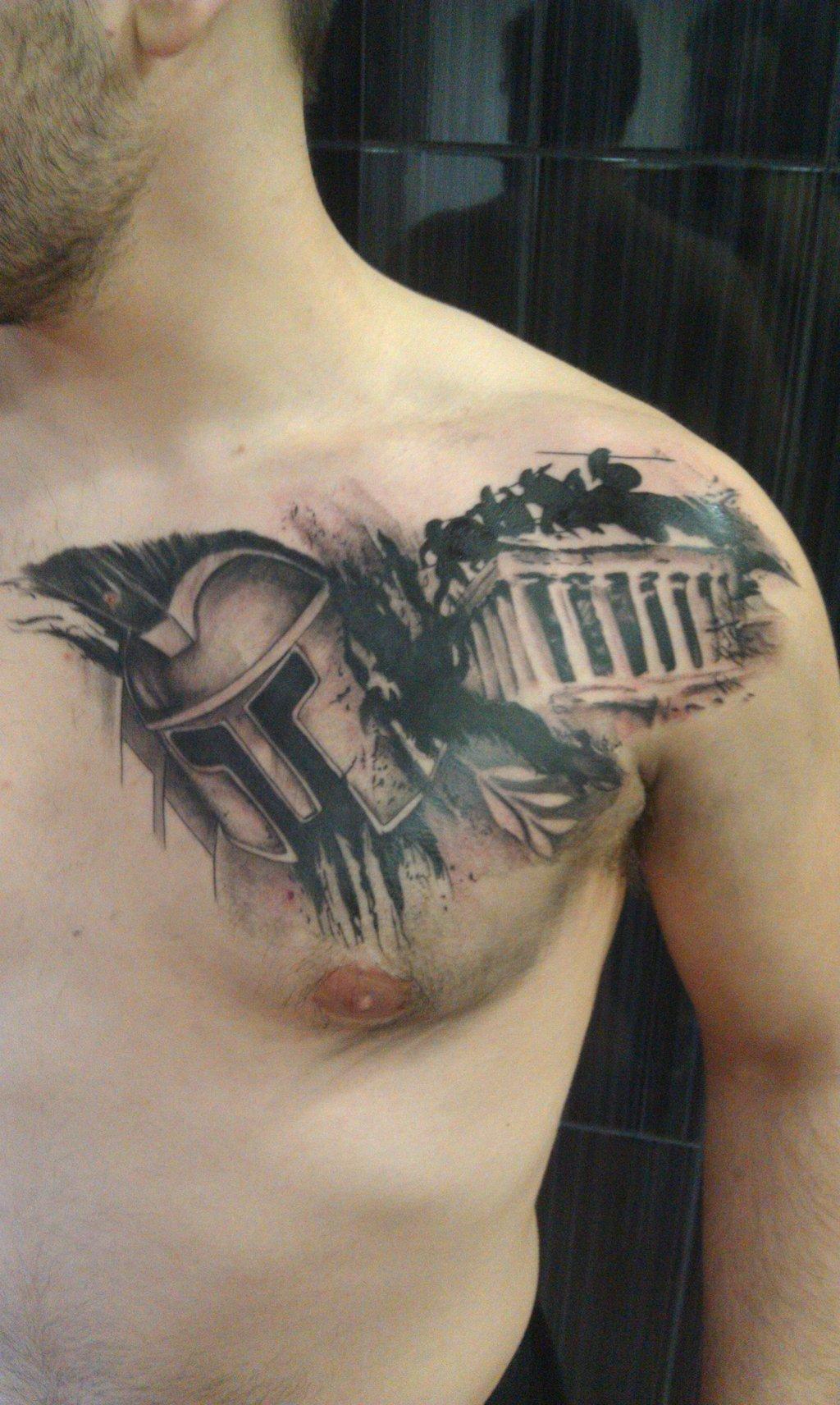 awesome black ink greek tattoo on man chest. Black Bedroom Furniture Sets. Home Design Ideas