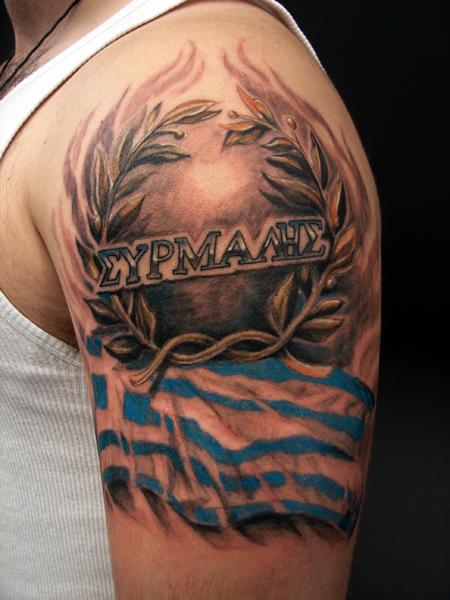 Greek Tattoo On Man Left Half Sleeve