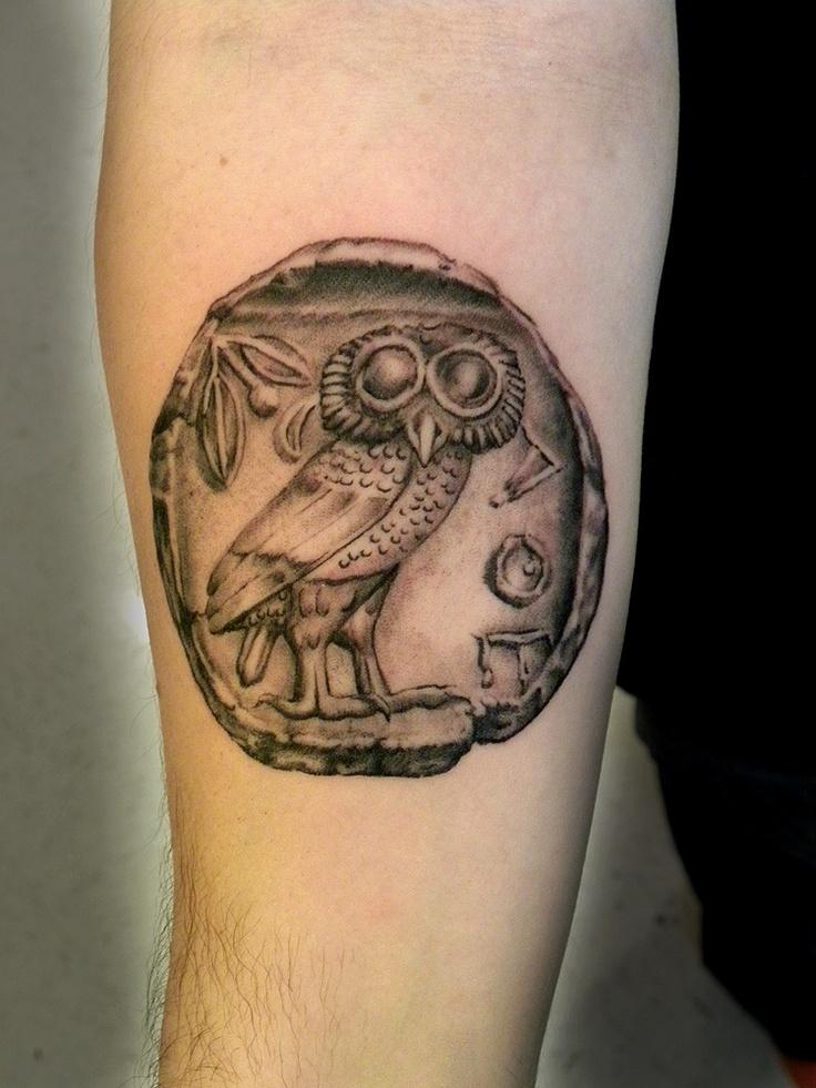 Grey Ink Small Greek Tattoo On Leg