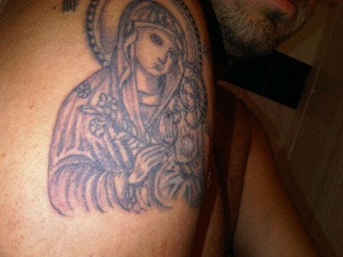 Grey Ink Greek Religious Tattoo