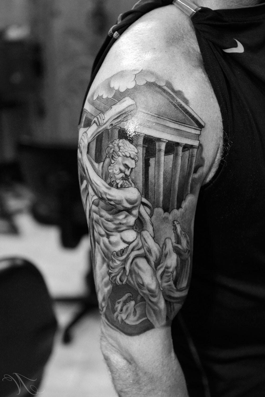 Unique Grey Ink Greek Tattoo On Half Sleeve