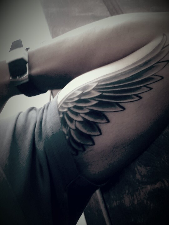 Grey Ink Wing Tattoo On Left Bicep