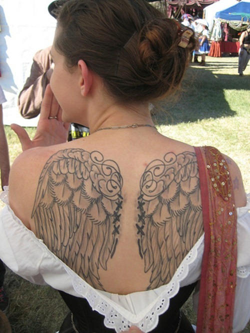 Woman With Angel Wings Tattoo