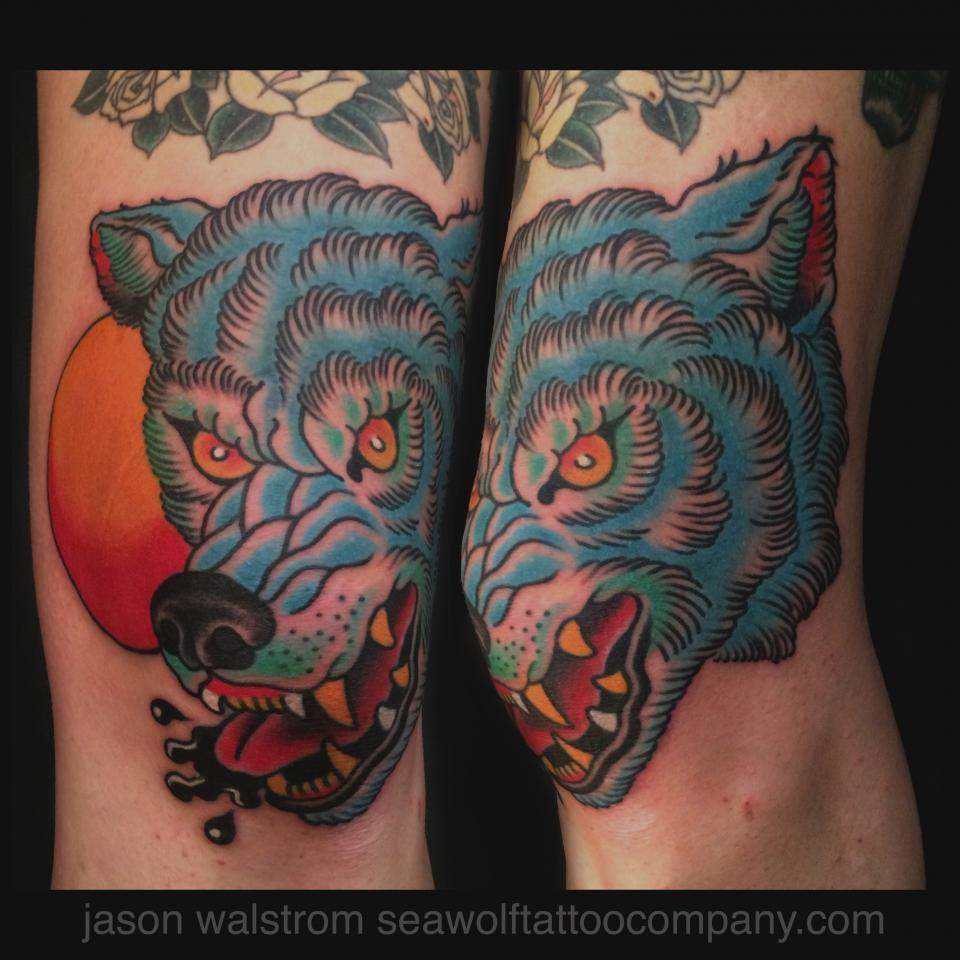 White And Blue Wolf Blue Ink Wolf Head Tattoo