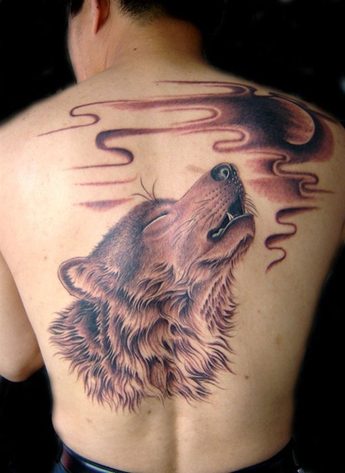 howling wolf with moon tattoo on back. Black Bedroom Furniture Sets. Home Design Ideas