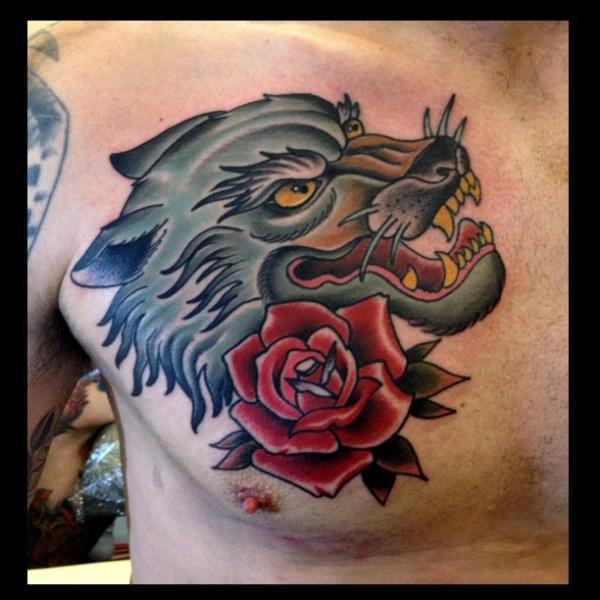 Red rose and wolf head tattoo on man chest for Red wolf tattoo