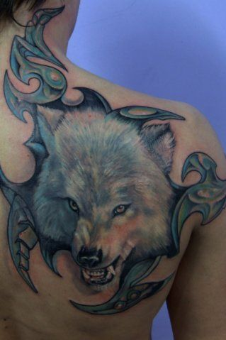 Tribal And Wolf Head Tattoo On Right Back Shoulder