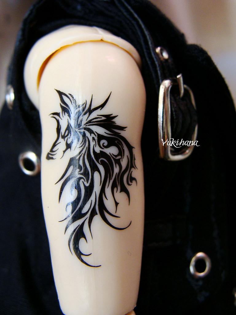 Tribal Wolf Heads Tattoos Designs
