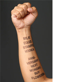lettering animated tattoo on right forearm