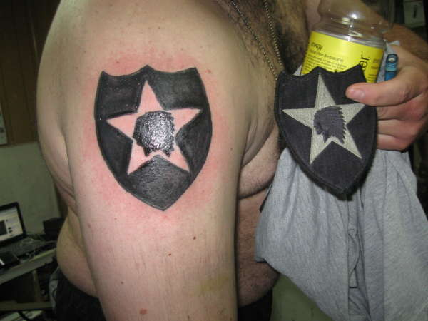 Army Logo Tattoo On Right Shoulder