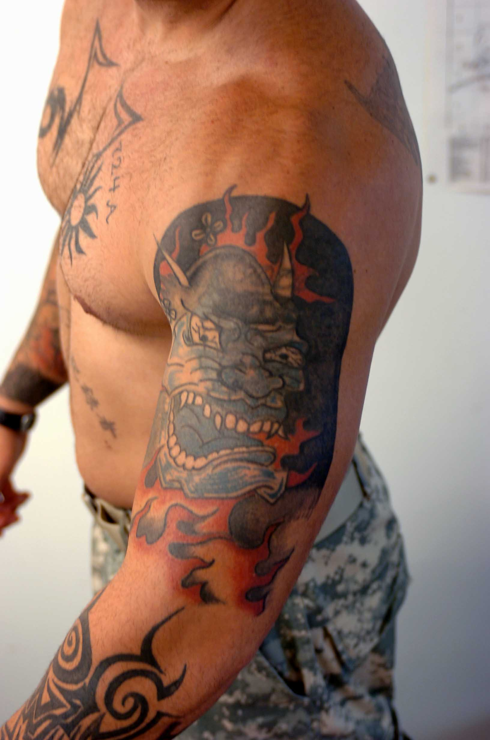 Wonderful Army Tattoo On Man Left Sleeve