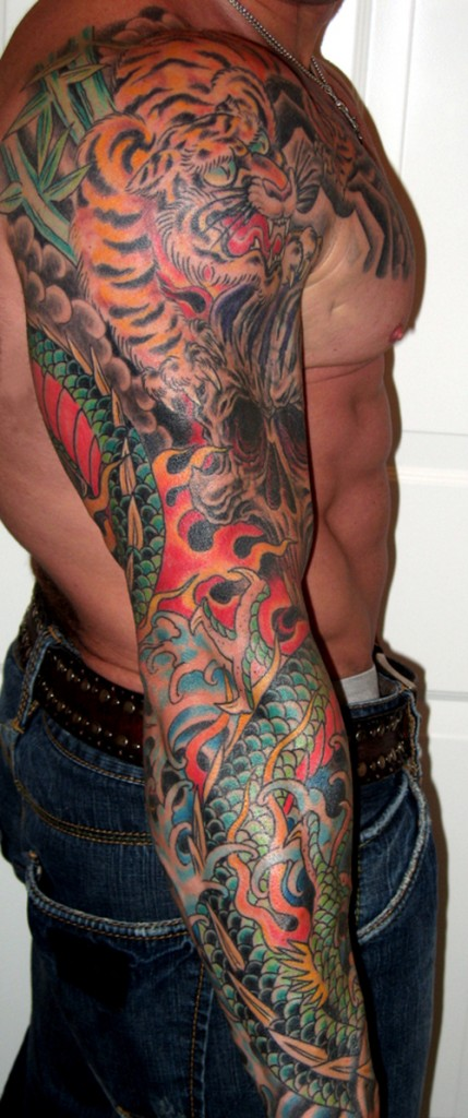 awesome colored arm tattoo for men. Black Bedroom Furniture Sets. Home Design Ideas